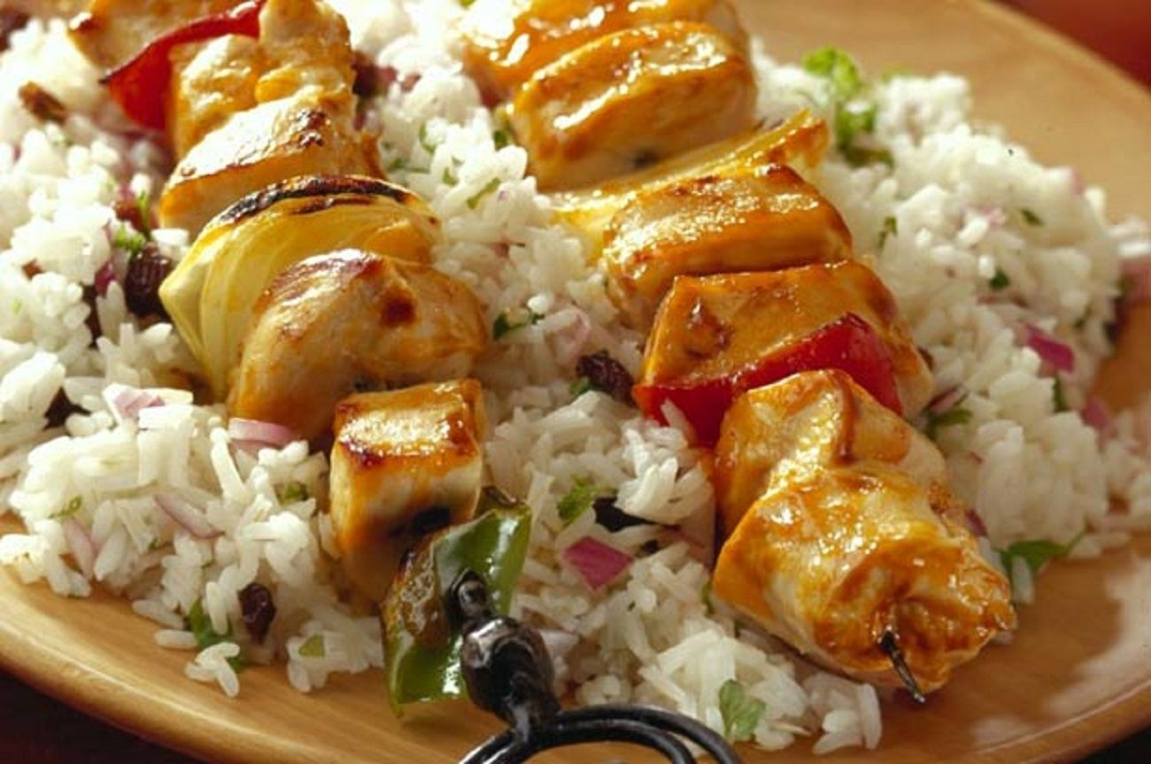 chicken kebabs on jewelled rice